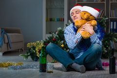 The man celebrating christmas at home alone Stock Images