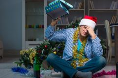 The man celebrating christmas at home alone Stock Photography