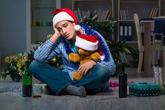 The man celebrating christmas at home alone. Man celebrating christmas at home alone Stock Photos