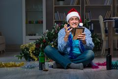 The man celebrating christmas at home alone. Man celebrating christmas at home alone Stock Images