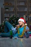 The man celebrating christmas at home alone. Man celebrating christmas at home alone Stock Photography