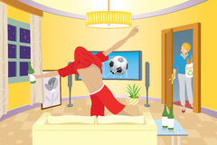 A man celebrating in front of television. Young man celebrating in front of television Royalty Free Stock Photo