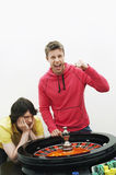Man Celebrating Gambling Win At Roulette Table Royalty Free Stock Photography