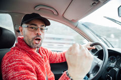 Man celebrating a goal while driving Royalty Free Stock Photo