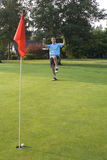 Man Celebrating Golf Shot - Vertical. Man about to break his putter after missing - Vertically framed shot Stock Photography