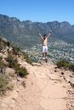 Man celebrating on lions head Stock Photos