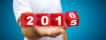 Man celebrating the new year 2016. Man holding 2016 dices for the new year Stock Photos