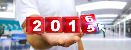 Man celebrating the new year 2016. Man holding 2016 dices for the new year Stock Photo