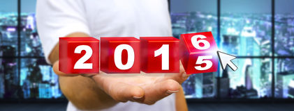 Man celebrating the new year 2016. Man holding 2016 dices for the new year Stock Image