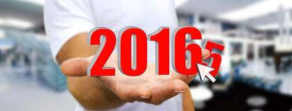 Man celebrating the new year 2016. Man holding 2016 dices for the new year Royalty Free Stock Images
