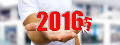Man celebrating the new year 2016. Man holding 2016 dices for the new year Royalty Free Stock Photos
