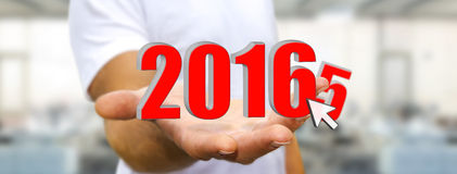 Man celebrating the new year 2016. Man holding 2016 dices for the new year Royalty Free Stock Image