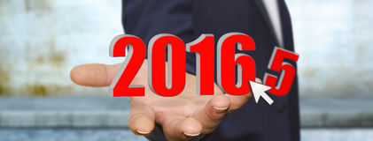 Man celebrating the new year 2016. Man holding 2016 dices for the new year Stock Photography