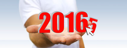 Man celebrating the new year 2016. Man holding 2016 icon for the new year Royalty Free Stock Photo