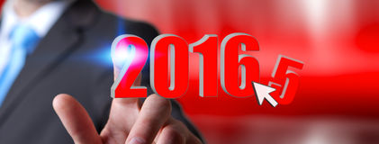 Man celebrating the new year 2016. Man holding 2016 icons for the new year Royalty Free Stock Photography