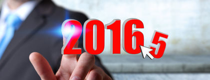 Man celebrating the new year 2016. Man holding 2016 icons for the new year Stock Images