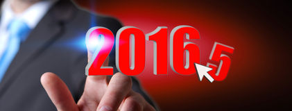 Man celebrating the new year 2016. Man holding 2016 icons for the new year Royalty Free Stock Images