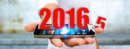 Man celebrating the new year 2016. Man holding 2016 icons for the new year Stock Photo