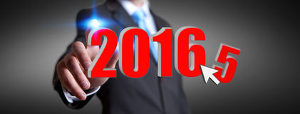 Man celebrating the new year 2016. Man holding 2016 icons for the new year Royalty Free Stock Photo
