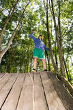 Man Celebrating Success After Climbing Wooden Slope Royalty Free Stock Images