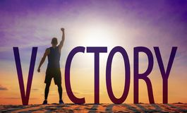 Man celebrating success. Victory text and person as silhouettes against sun in sky stock image