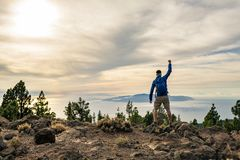 Man celebrating sunset looking at view in mountains Royalty Free Stock Photography