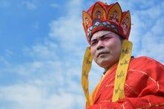 Man celebtares chinese festival. Old man celebtares chinese festival wearing ethno clothes Royalty Free Stock Photo