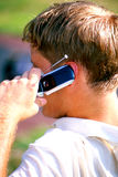 Man on Cell. Side view on man talking on a cell phone Royalty Free Stock Image