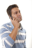 Man with a cell phone. A young man using a cell phone Royalty Free Stock Image