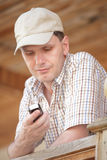 Man with cell phone. On the wooden porch Stock Images