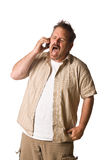 Man on cell phone. Young Man on cell phone, screaming. On-white Stock Photos