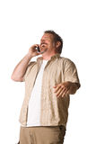 Man on cell phone. Young Man on Cell Phone. Happy, Laughing Expression Royalty Free Stock Photography