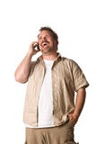 Man on cell phone. Young Man on Cell Phone. Happy, Laughing Expression Stock Photo