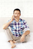 Man With Cell Phone. Asian man with cell phone talking Stock Photography