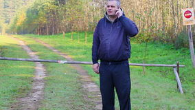 Man with cell phone at the barrier stock footage