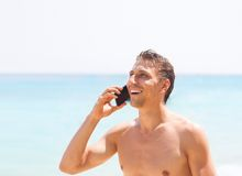 Man cell phone call smile on beach summer vacation. Tourist communication sea travel Royalty Free Stock Photos
