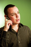 Man with cell phone ear piece. Young man with cell phone ear piece on ear Stock Images