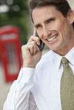 Man On Cell Phone In London & Red Telephone Box Royalty Free Stock Photography