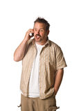 Man on cell phone - mad. Man on white. Cell phone with getting frustrated expression Royalty Free Stock Photo