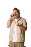 Man on cell phone - mad. Man on white. On cell phone with MAD screaming expression Royalty Free Stock Images