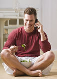 Man With Cell Phone and Salad Royalty Free Stock Images