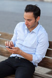 Man with cell phone Stock Images