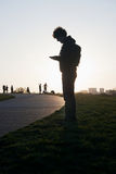 Man with cellphone in park Stock Image