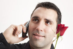 Man, Cellphone, Red Rose Stock Photos