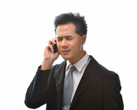 Man with cellphone. Young Asian business man with cellphone Royalty Free Stock Image