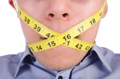 Man with centimeter Stock Photography