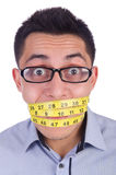 Man with centimeter Stock Images