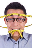 Man with centimeter Royalty Free Stock Photo