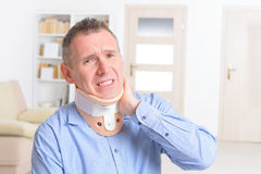Man in cervical collar Stock Images
