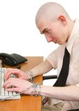 Man and chain. Man riveted chain to keyboard on the white background Royalty Free Stock Images